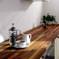Solid Iroko Kitchen Worktop - very affordable but has got same quality as teak, waterproof and will last forever. Oil it every 6 mths, maybe more often the 1st yr.