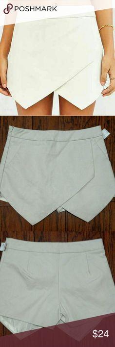 "NWT Glamorous envelope skort. Size XS Side IP. Off white faux leather. Glamorous for Urban Outfitters. Waist 28"" Urban Outfitters Shorts Skorts"