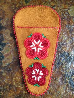 A personal favorite from my Etsy shop https://www.etsy.com/listing/290590027/athabascan-beaded-scissor-case