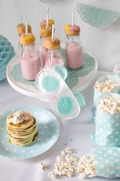 pink milk, pancake and donuts are the perfect accompaniments for a sweet dreams pajama party cake stand by Donna Hay Donuts by Dunkin Donuts Styling by Little Monster Co Pancakes by mum Party products by Little Monster Co Sleep mask by Typo Glass bottles by Reject shop