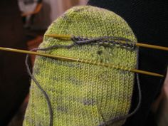 A method for darning socks. The repair is knitted into the existing knit.