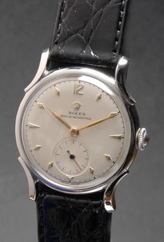 """Rolex 1950's (model ref:- 4542) Shock Resisting with the most unusual and scarce, sculpted """"Horn"""" lugs. Struck inside with the Rolex model reference number 4542, signed """"Rolex Geneve Suisse""""."""