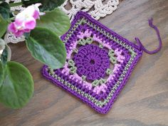 granny square-pretty color combo.  No directions here, but should be able to duplicate from pix.