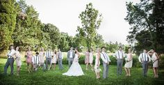 A great, staggered posing idea for a wedding party | Gallery D Photography
