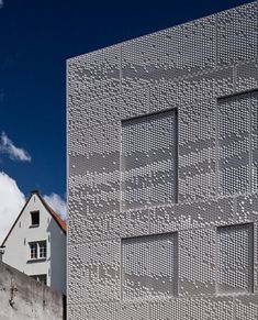 Dutch designer Chris Kabel was approached by architecture studio Abbink X de Haas to wrap this house and studio in Amsterdam with a facade of perforated hexagons that catches the light like a hanging sheet of fabric.