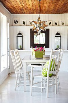 Laura Hay Decor Design - dining rooms - star shaped pendant light, green planter, pink flowers, mirrored star pendant, white dining table, g...