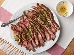 Simple Broiled Flank Steak with Herb Oil : Flank steak is a relatively lean cut of meat but full of flavor. This preparation is low on the fussiness factor: Put your seasoned steak on a preheated broiler pan and cook, no flipping needed. Marinated Flank Steak, Flank Steak Recipes, Beef Recipes, Cooking Recipes, Healthy Recipes, Healthy Meals, Easy Recipes, Food Dinners, Ina Garten