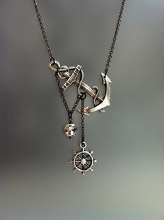 Reserved Lost at Sea Necklace by SBC Silver Plated Anchor Faceted Silver Pyrite Silver Ship Wheel Gunmetal Chain Free Shipping Made to Order. $26.99, via Etsy.