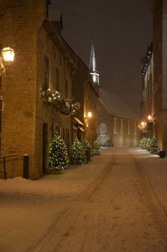 Quiet snowy street at night