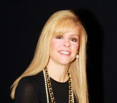 Leigh Anne Tuohy... I admire people who make a positive difference to others, and love doing it