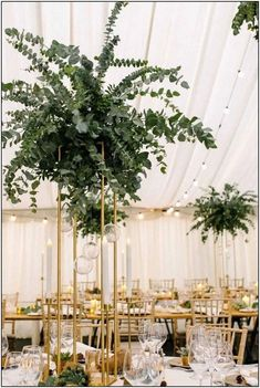 Beautiful Botanical elevated designs of Eucalyptus with an under canopy of gold, candlelight and succulents at Middleton Lodge North Yorkshire Wedding Flowers Wedding & Events Floral Design Tall Wedding Centerpieces, Bohemian Wedding Decorations, Branch Centerpieces, Bridal Flowers, Flower Bouquet Wedding, Floral Flowers, Marquee Wedding, Wedding Table, Lodge Wedding