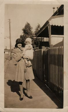 Mum being held by her Mum (Janet Ivy Renison nee Gray) at Francis Street Richmond 1930.