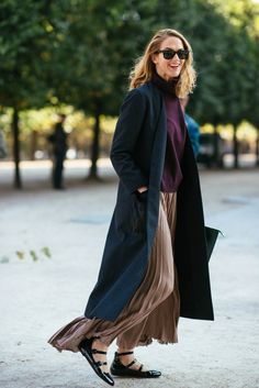 long coat and pleated skirt  | for more style inspiration visit 40plusstyle.com