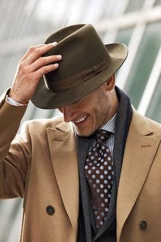 Men are so dashing when they wear a fedora such as this. My father always wore and hat and still does. It's a fashion accessory that needs to return. Say good-bye to baseball caps forever...please.