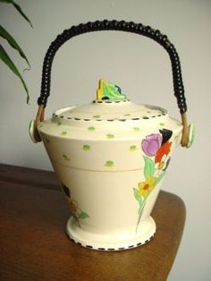 Burleigh Ware Fragrance pattern biscuit barrelis complete with original bound cane handle  SIZE 22.5cms) H to the top of the handle (16.5cms to the top of the finial on the lid) x 17.7cm in total width. Worthpoint/eBay