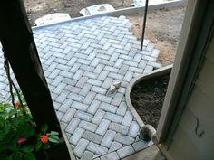 White Herringbone Pavers.  Via Doityourself.com.