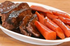 Soy-Braised Pot Roast with Carrots is a delicious variation of roast beef that cooks on top of the stove! When I made White Bean Soup back in October, I shared a photo of my new blue enamel covered cast-iron dutch oven by Chantal, the pan that may be responsible for my current love of pot …