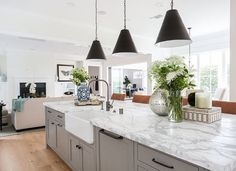 This modern farmhouse style home was interior designed by Blackband Design in along with Graystone Custom Builders, residing in Newport Heights, California. Modern Farmhouse Kitchens, Modern Farmhouse Style, Home Kitchens, White Farmhouse, New Kitchen, Kitchen Dining, Kitchen Decor, Island Kitchen, Long Kitchen