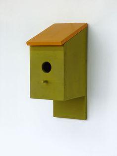 Orange green wooden handmade birdhouse with bird perch. $55,00, via Etsy.