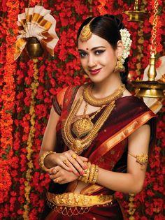 South Indian bride. Temple jewelry. Jhumkis.Red silk kanchipuram sari.Braid with fresh flowers. Tamil bride. Telugu bride. Kannada bride. Hindu bride. Malayalee bride.Kerala bride. South Indian wedding.