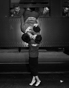 a soldier leans out of a train to kiss a woman goodbye in California, 1950