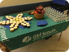 Our Dessert Table for the Girl Scout Daisy Investiture Ceremony.  Cupcakes in the shape of a daisy, pretzels and water. #girlscouts #investiture