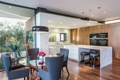 This kitchen has a long kitchen island with stool seating, and a smaller casual dining area right beside it.