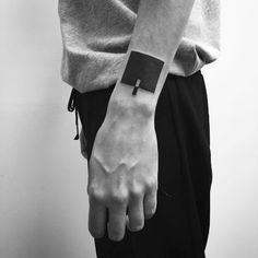 square tattoo on hand