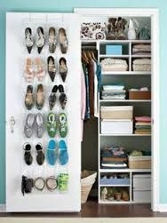 Organized Closet With Overdoor Shoe Holder.