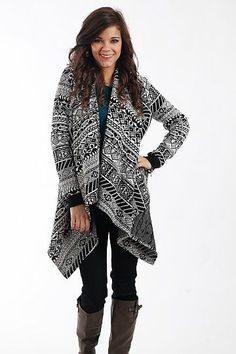"""All Over It Cardigan, Black $41.00 A little black and white never hurt anybody, and we are all over this cardigan! The tribal patterns are right on trend and we love the long draped collar in the front. Slip it on over a cami or even your favorite t-shirt for warmth and a cozy feel.   Fits true to size. Miranda is wearing a small.   From shoulder to hem:  Small - 29""""  Medium - 30""""  Large - 31"""""""
