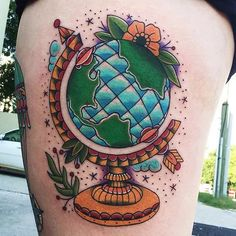 Very detailed traditional globe tattoo, by Kris Close.