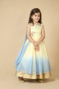 Net gown embellished with sequins and floral applique. Item number KG15-04