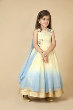 Net gown embellished with sequins and floral applique. Item number KG15-04