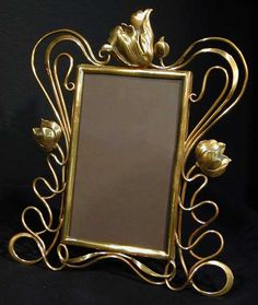 Art Nouveau brass picture frame with floral decoration, ca.1902