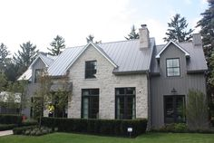 I like the color scheme on this house. Black framed windows, neutrals, masonry that appears to be painted.