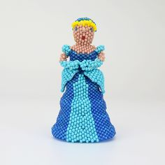 """Zuni artists, Farlan and Alesia Quetawki hand beaded Cinderella. Using one seed bead at a time, they flawlessly created this piece of beadwork with the peyote stitch. A unique addition to your Zuni Beadwork or Native American art collection. Signed 3 1/4"""" tall x 1 3/4"""" long x 1 5/8"""" wide Artist card included"""