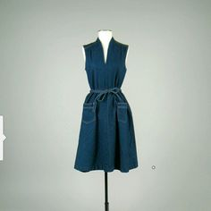 """Vintage Sasson denim dress Very cute denim dress I bought from Etsy a few years ago. It's too small for me now. Can be worn in all seasons w the right accessories. Matching tie belt. Front pockets. Measurements:  Bust: 36"""" Waist: 28"""" Hip: free Length: 40"""" sasson Dresses Midi"""