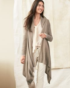 This draped-front cardigan is one to live in, from business meetings to baseball games, with leggings or jeans. Supremely cozy and impeccably styled, with a flattering shape, a dramatic high-low hem, and a flowing drape.