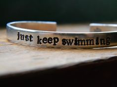 just keep swimming bracelet 1/4 inch wide by LindaMunequita on Etsy https://www.etsy.com/listing/154795951/just-keep-swimming-bracelet-14-inch-wide