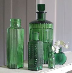 collection of green glass vintage bottles....I love my old green bottles!