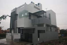 Arun's Bungalow Front Elevation - Actual site image of Bungalow Designs by Ashwin Architects in Bangalore.    Call (+91)-(80)-26612520 for more inforamation or visit http://www.ashwinarchitects.com
