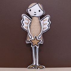 Love it.  SWEET ANGEL sewing pattern kit by happysewluckyshop on Etsy, $20.00