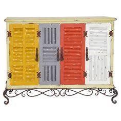 Aménagez votre propre cabinet de curiosités grâce à ce meuble atypique sur pieds en fer forgé à volutes. Ses placards à portes multicolores égayent v...