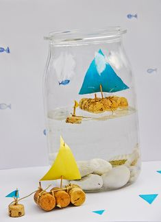 DIY : Cork sail boat in a jar.  Would make cute centerpieces for a baby shower!