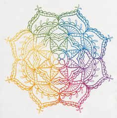 Intricate lines make up this exquisite rainbow ombre medallion. Stitch onto jackets, home decor, and more!