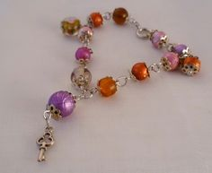"""""""Eiscreme-Armband"""".   Fruchtig-frische Glasperlen in Gelb und Orange, knallig-glänzende Baliperlen in Violett, Pink und rot, Lampworkperlen mit Blumen"""