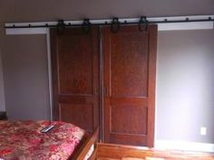 Eric and I installed these antique doors on antique barn door rollers and track a couple of weeks ago.