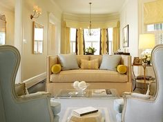 love the combination of soft blue and yellow; photo via the Portfolio of Palmer Weiss Interior Design