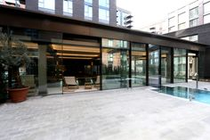 See how slim framed sliding glass doors were used on these luxury swimming pool facilities at the new Embassy Gardens development in Nine Elms, London.