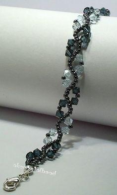 Make with Swarovski Crystal and Janpanese seed bead.
